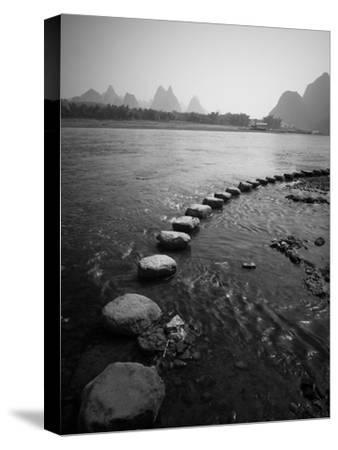 A Stone Pathway Crosses the River in Guilin, China by Ben Horton