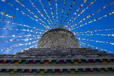A stupa in the foothills of Mount Siguniang. by Ben Horton
