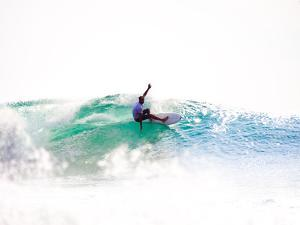 A Surfer Exits the Barrel over a Shallow Reef in Indonesia by Ben Horton