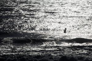 A Surfer Sits Alone Out in the Waves by Ben Horton