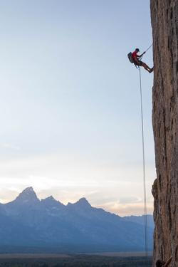 Climber Rappelling Down Boulder by Ben Horton
