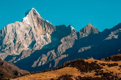 Early morning light on Mount Siguniang on the Tibetan Plateau. by Ben Horton