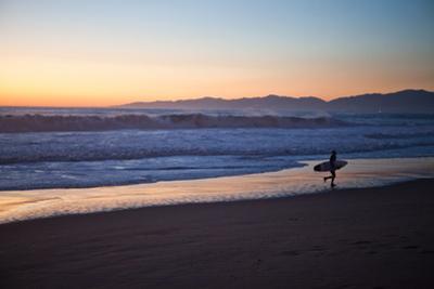 El Porto Beach, Los Angeles, California, USA: A Surfer Exits the Waves at Dusk by Ben Horton