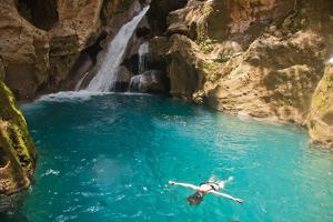 Jacmel, Haiti: A Swimmer Floating in Basin Bleu by Ben Horton