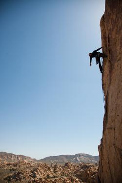 Joshua Tree National Park, California: A Trad Climber Rests While Climbing a Vertical Rock Face by Ben Horton