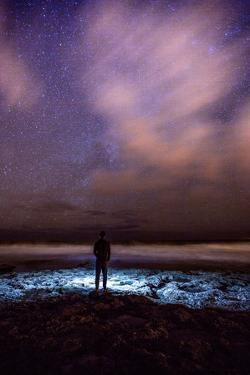 Silhouette of Man Watching Waves Beneath the Milky Way by Ben Horton