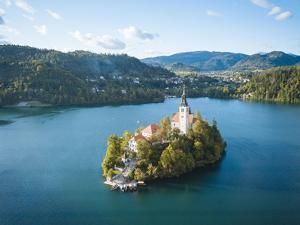 Aerial view by drone of Bled Island with the Church of the Assumption at dawn, Slovenia by Ben Pipe