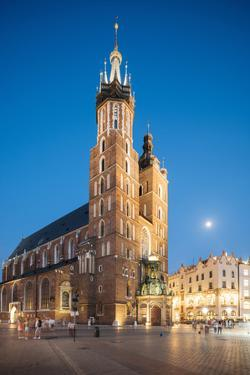 Exterior of Saint Mary's Basilica in Market Square at night, Krakow, Poland by Ben Pipe