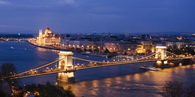 View over River Danube, Chain Bridge and Hungarian Parliament Building at Night by Ben Pipe