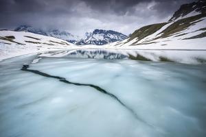 Thawing Alpine Lake, Vanoise National Park, Rhône-Alpes, France, June by Benjamin Barthelemy