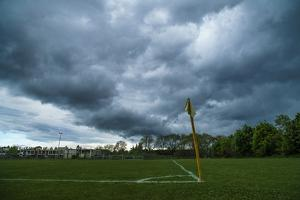 Dark clouds above a football pitch by Benjamin Engler