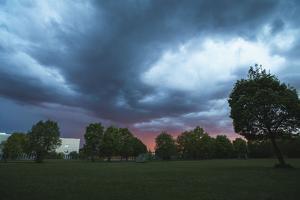 Dark clouds above a park by Benjamin Engler
