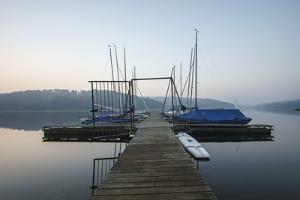 Germany, North Rhine-Westphalia, Sorpe Dam, Bridge, Boats, Dusk by Benjamin Engler