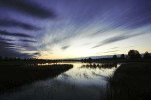 Long-Exposure Photography, Lake with Cloud Cover, Water Reflection by Benjamin Engler