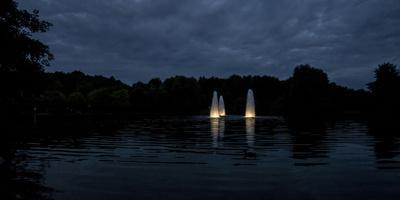 Night Photography Lake with Illuminated Water Fountains