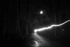 time exposure, beam of light at night, Germany by Benjamin Engler