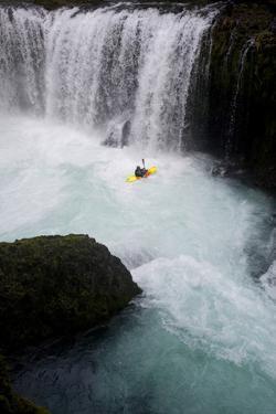 A Kayaker Beneath Spirit Falls on the Little White Salmon River in Washington by Bennett Barthelemy