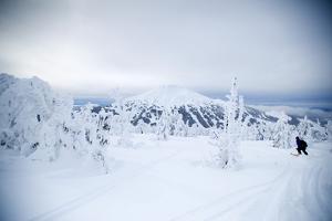 A Man Backcountry Skiing on Mt. Tumalo, Oregon Cascades by Bennett Barthelemy