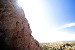 A Man Lead Climbing a Sport Route at Cochise Stronghold in Southern Arizona by Bennett Barthelemy