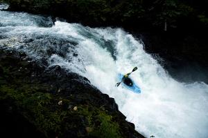 A Professional Kayaker on Bz Falls on the White Salmon River in Washington by Bennett Barthelemy