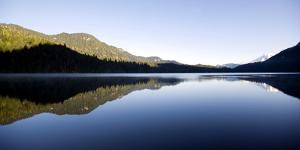 A View of Mt. Rainier Reflected in Packwood Lake, Washington by Bennett Barthelemy