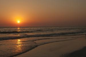 Sunset across Quiet Surf, Crescent Beach, Sarasota, Florida, USA by Bernard Friel