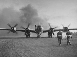 B-29 at Chinese Base, Revving Giant Propellers as it Prepares to Bomb Japan by Bernard Hoffman
