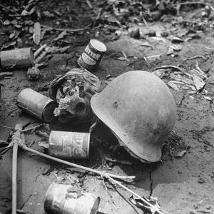 Human Skull, an Army Helmet, and Canned Food by the Side of the Ledo Road, Burma, July 1944 by Bernard Hoffman