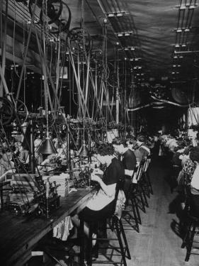 Men and Women Working in the Elgin National Watch Co. Factory by Bernard Hoffman