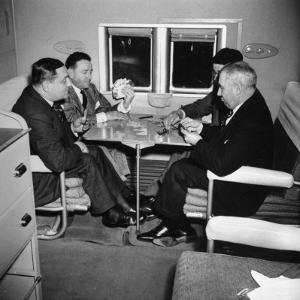Men Playing a Card Game While Riding Aboard the Atlantic Clipper by Bernard Hoffman