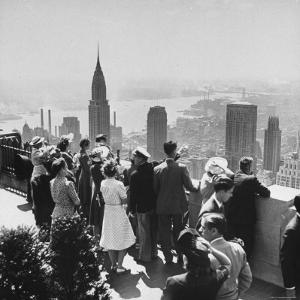 Sightseers Taking a Guided Tour on Top of the Rockefeller Center Post Office's Roof by Bernard Hoffman