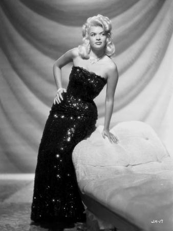 Jayne Mansfield Posed and sitting on the Couch in Black Sequin Silk Shoulder Dress
