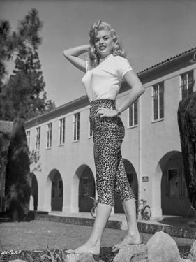 Jayne Mansfield Posed in White Short Sleeve Shirt and Black High Waist Tight Pants with Left Waist by Bert Six