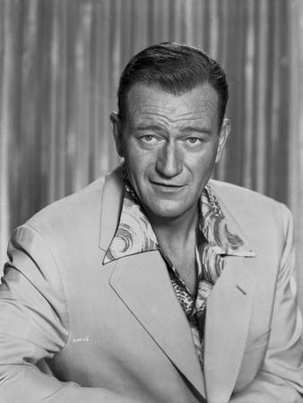 John Wayne wearing a White Suit with a Hawaiian Undershirt