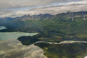 A River Muddy with Glacial Silt Pours into the Blue-Green Waters of Lake Clark by Beth Wald
