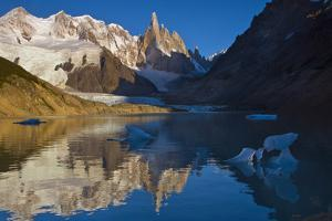 Adela and Cerro Torre Massifs Reflected in the Laguna Torre At Dawn by Beth Wald