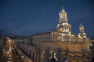 At Dusk, Cars Drive and People Stroll Past La Catedral and the Plaza De Armas by Beth Wald