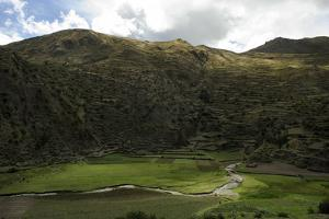 Bright Green Fields Along the Patacancha River Below Hillside Ancient Terraces by Beth Wald
