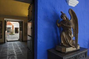 Carved Wooden Angels Guard a Hallway in the Restored 1730 Mansion Casa De Moral by Beth Wald