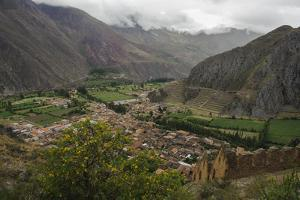 Ruins of an Incan Fortress Cling to a Steep Hillside Above Ollantaytambo by Beth Wald