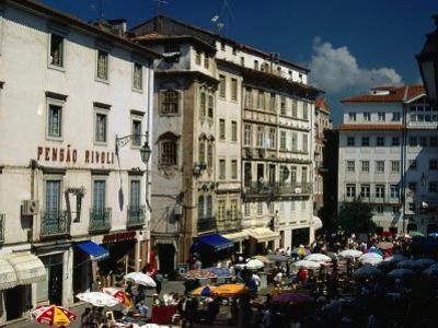 Market and Buildings in City Street, Coimbra, Portugal by Bethune Carmichael