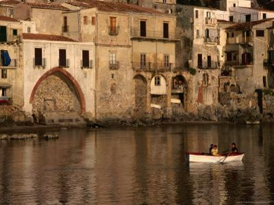People Rowing Boat in Town Harbour, Cefalu, Italy by Bethune Carmichael
