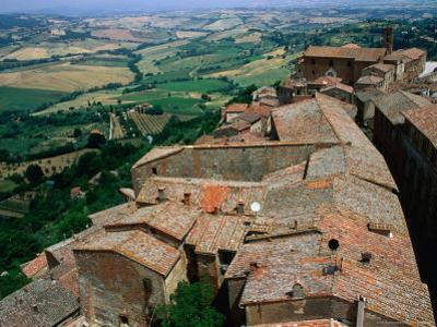 Rooftops of Town Overlooking Tuscan Countryside, Montepulciano, Italy by Bethune Carmichael