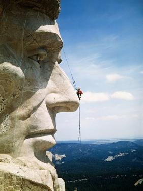 Mount Rushmore Repairman Working on Lincoln's Nose by Bettmann