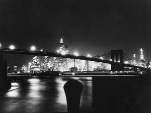 Night View of Brooklyn Bridge by Bettmann