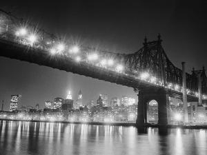 Queensboro Bridge and Manhattan at Night by Bettmann