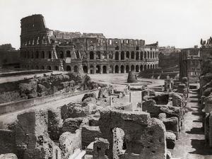 Roman Colosseum and Surrounding Ruins by Bettmann
