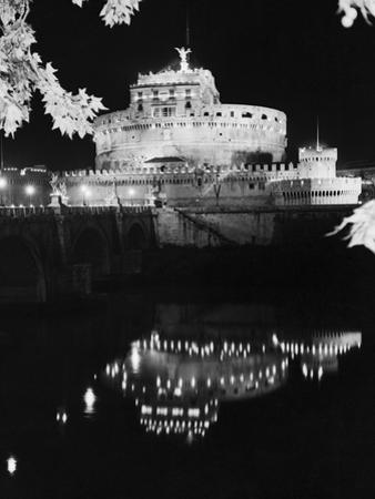 St. Angelo Castle Reflecting in the Tiber River by Bettmann