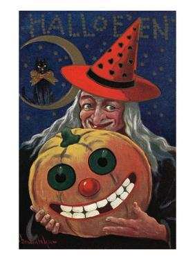 Witch Holding a Pumpkin by Bettmann