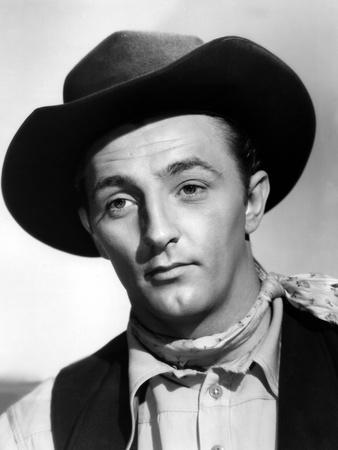 https://imgc.allpostersimages.com/img/posters/beyond-the-last-frontier-by-howard-bretherton-with-robert-mitchum-1943-b-w-photo_u-L-Q1C2HOG0.jpg?artPerspective=n